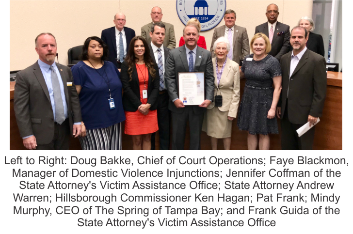 Picture of people showing from left to right: Doug Bakke, chief of court operations; Faye Blackmon, manager of domestic violence injunctions; Jennifer Coffman of the State Attorney's Victim Assistance Office; State Attorney Andrew Warren; Hillsborough Commissioner Ken Hagan; Pat Frank; Mindy Murphy, CEO of The Spring of Tampa Bay; and Frank Guida of the  State Attorney's Victim Assistance Office